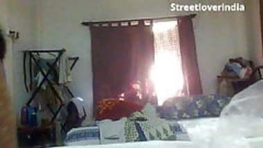 Sexy Indian Bengali Aunt Mili captured changing in bedroom